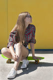 Stylish cheerful young girl with skateboard Royalty Free Stock Photography