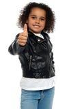 Stylish child savoring sweet success Stock Photos