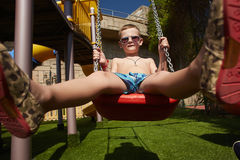 Stylish child in sunglasses on summer vacation Stock Images