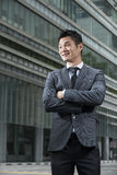 Stylish Chinese business executive looking away Royalty Free Stock Photography