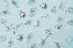 Stylish christmas background with confetti, serpentine and silver stars top view. Flat lay. Royalty Free Stock Image