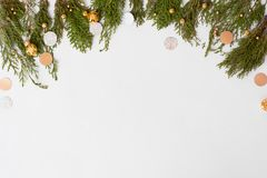 Stylish christmas composition. fir branches and christmas decorations on white background. flat lay top view. royalty free stock photography