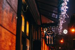 Stylish christmas decorations, garland lights on window of cafe stock photo