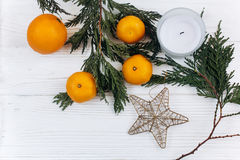 Stylish christmas flat lay with green branches and oranges and g royalty free stock photo