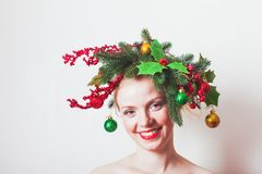 Stylish Christmas headdress. Woman in Christmas wreath. Stylish headdress for holiday party or photo shooting Royalty Free Stock Photo