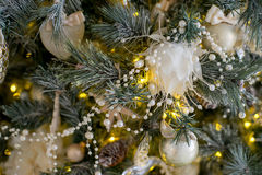 Stylish Christmas interior decorated in white and golden colors Stock Photos