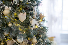 Stylish Christmas interior decorated in white and golden colors Stock Photo