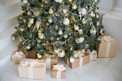 Stylish Christmas interior decorated in white and golden colors Stock Image