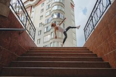 Stylish city boy dancing, practicing jumping Stock Images