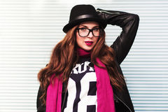 The stylish city girl in sunglasses shows a fashionable look Royalty Free Stock Photo