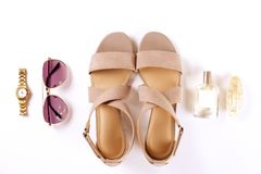 Top view of fashionable feminine medium heeled women`s leather shoes of pastel colors on heels / wedge for spring-summer season. Stylish classic beige women stock photo