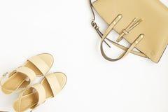 Fashionable medium heeled women`s leather wedge shoes isolated on white. stock photos