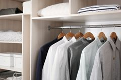 Stylish clothes and home stuff in large wardrobe. Closet royalty free stock image