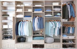 Stylish clothes, shoes and home stuff. In large wardrobe closet stock photos