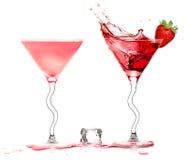 Stylish Cocktail Glasses with Strawberry Liquor Splashing isolat Stock Images