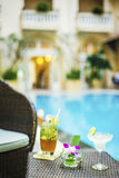 Stylish cocktails in exotic tropical pool side bar Stock Photography