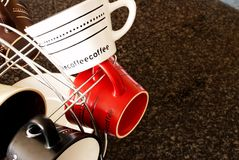 Stylish coffee cups in the kitchen. Stylish colorful coffee cups on the marble kitchen counter royalty free stock photo