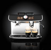 Stylish coffee machine brewing espresso in two glasses. Stock Images