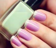 Stylish colorful nails and nailpolish Royalty Free Stock Photography