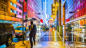 Free Stylish Colorful Wet New York NYC Commuter With Umbrella Stock Photos - 160228023