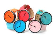 Stylish colorful wrist watches on white background. Fashion accessory royalty free stock image