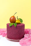 Stylish colors Marsala cake decorated with pears and tangerines on a pastel yellow background Stock Photo