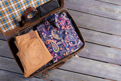 Stylish complex set in a suitcase. Men's clothing in a retro suitcase. Set of traveler royalty free stock photos