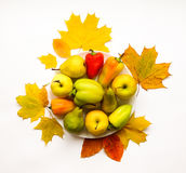 Stylish composition of vegetables, fruits, autumn leaves. Top view on white background. Autumn flat lay Royalty Free Stock Photos