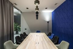 Stylish conference room with gray and blue walls Royalty Free Stock Photography