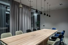 Stylish conference room with gray and glass walls Stock Images
