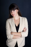 Stylish confident business woman in suit smiles Stock Photography