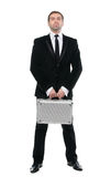 Stylish confident  businessman with metal suitcase. Full-length. Stock Image