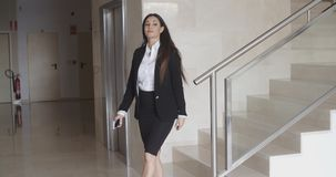 Stylish confident businesswoman walking indoors stock footage