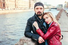 Stylish couple in city . Beautiful couple in love hugging and kissing Royalty Free Stock Photo