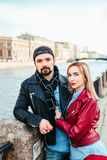 Stylish couple in city . Beautiful couple in love hugging and kissing Royalty Free Stock Image