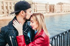 Stylish couple in city . Beautiful couple in love hugging and kissing Royalty Free Stock Photography