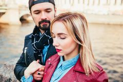 Stylish couple in city . Beautiful couple in love hugging and kissing Royalty Free Stock Images