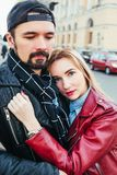 Stylish couple in city . Beautiful couple in love hugging and kissing Stock Photography