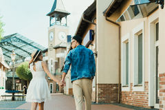 Stylish couple holding hands while walking on the street Royalty Free Stock Photo