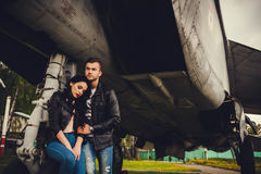 Stylish Couple hugging near the aircraft Stock Photography
