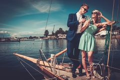 Stylish couple on a luxury yacht royalty free stock photography