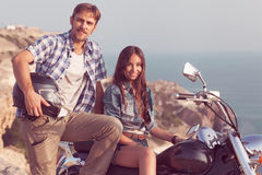 Stylish couple on a motorcycle Stock Photography