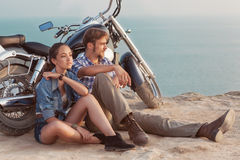 Stylish couple on a motorcycle stock photo