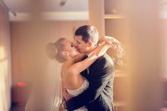 Stylish couple of newlyweds hugging, kissing and posing indoors Stock Photo