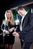 Stylish couple opening a bottle of champagne Stock Photo