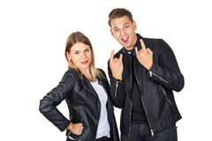 Stylish couple shwoing rock & roll Stock Images