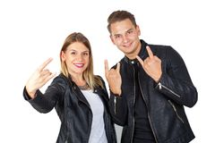 Stylish couple shwoing rock & roll Royalty Free Stock Images