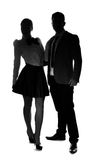 Stylish couple standing side by side Stock Images