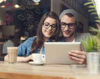 Stylish couple with tablet Stock Photo