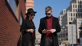 Stylish couple tourists take a photo of european attractions in city stock video